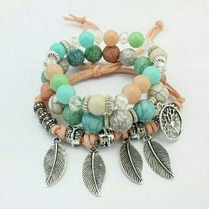 Jewelry - Owl Multi colored three set bracelets